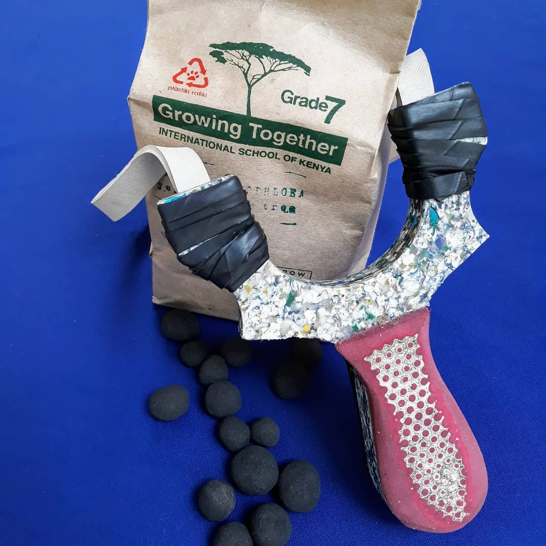 Recycled plastic slingshots and packets of indigenous acacia seed balls.